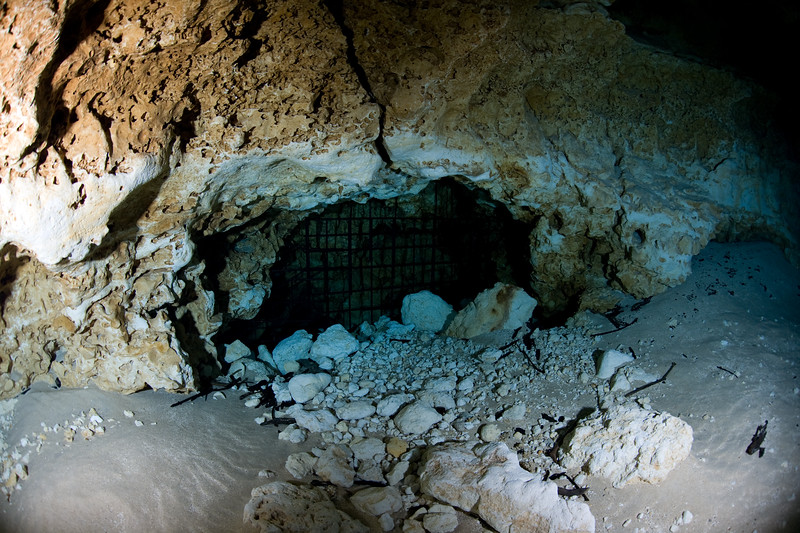 The grate keeping divers from entering the caves.
