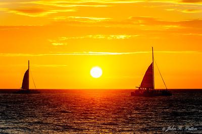 Catamarans at sunset.