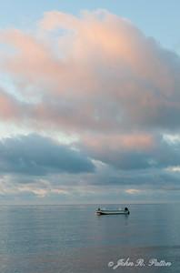 Lone boat at dawn.