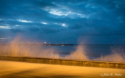 Waves hit seawall