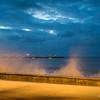 Waves hit seawall