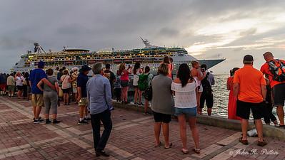 Tourists watching cruise ship