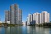 Apartment and condominium buildings along the Intracoastal Waterway at night near Brickell Key in Miami, Florida, USA.