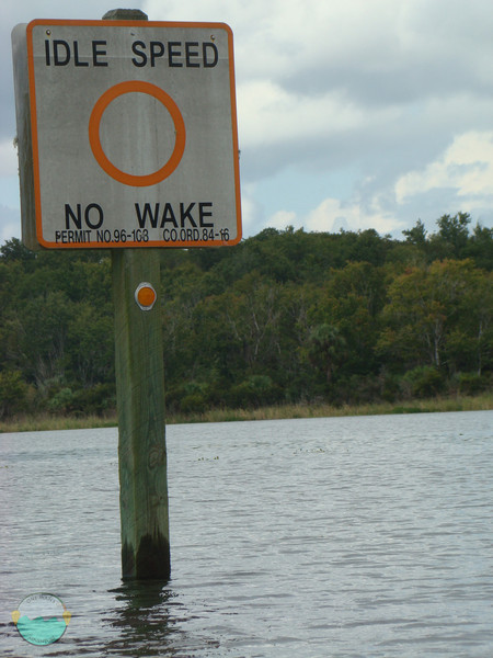 Idle Speed, no wake signage on the river.