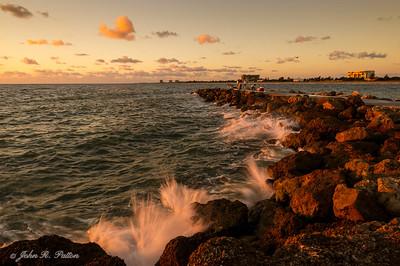 Waves hitting jetty at dawn 2.
