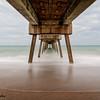 Waves coming through pier