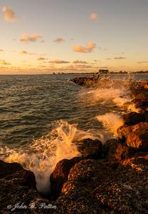 Waves hitting jetty at dawn 1.