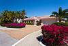 An island home with bougainvillea flowers on Sanibel Island, Florida, USA.