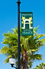 Lamp post  and welcome banner for historic Venice, Florida, USA.