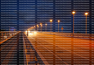 Cars and a bike rider travel at twilight on the 17th Street Causeway bridge in Fort Lauderdale, Florida.