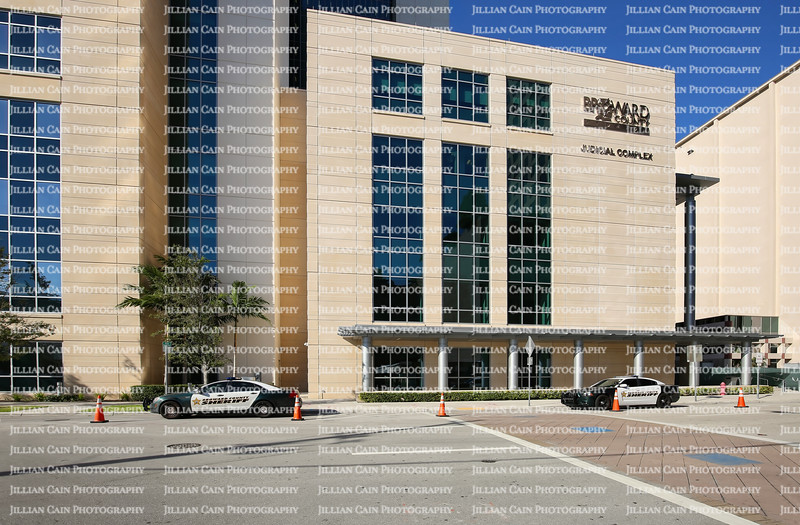 EDITORIAL USE ONLY:    Two Broward County Sheriff cars provide security in front of the Broward County Judicial Complex Building.