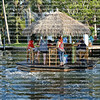 Motorized floating tiki bar cruises down the Intracoastal Waterway in Fort Lauderdale, Florida, USA.