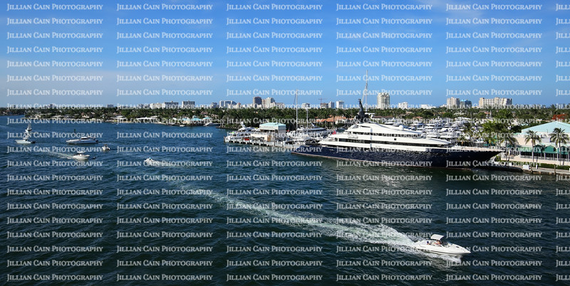Yachts and boats of all sizes navigating the Intracoastal waterway in Fort Lauderdale, Florida.  With 165 miles of waterway, Fort Lauderdale is known at the Yachting capital of the world.