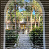 View of the Bonnet House courtyard as seen through an arch doorway.  The Bonnet House is listed on the National Register of Historic Places.
