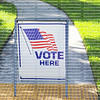VOTE HERE SIGN placed on the walkway to a neighborhood polling place, as seen on election day in Fort Lauderdale, Florida.