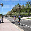 EDITORIAL USE ONLY:  Bicycle riders ride in the bike lane on Fort Lauderdale Beach,