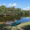 Canoe at the waters edge at Hugh Taylor Birch State Park in Fort Lauderdale, Florida, USA.