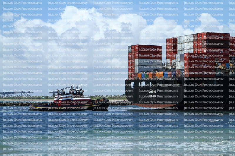 Container ship Venezia loaded with cargo is assisted into Port Everglades by tugboat Tate McAllister at the stern.