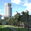 Aerial view of apartments, condominiums and large disk art in downtown Fort Lauderdale as seen from the Third Avenue Bridge.