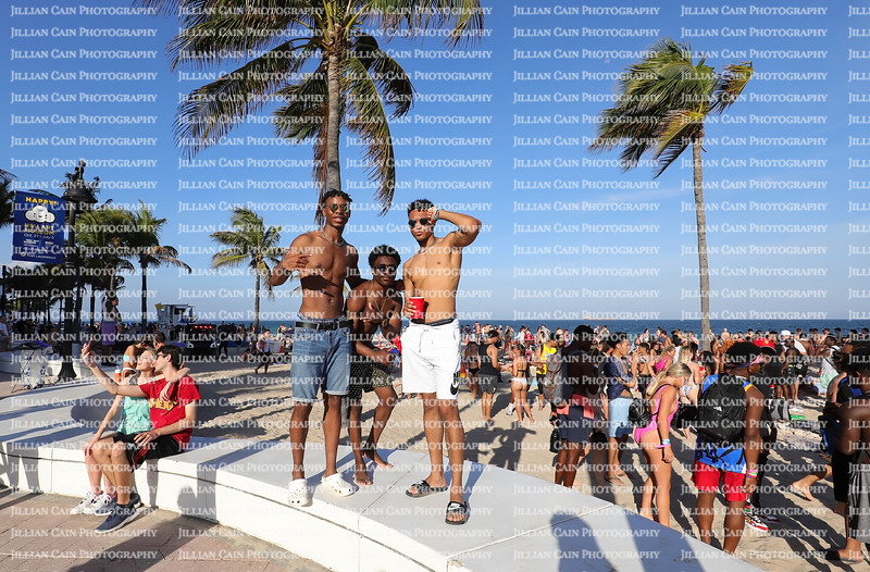 FORT LAUDERDALE, FLORIDA, USA:  Spring break college students enjoy a moment as their photo is taken in front of hundreds of college students as seen on March 5, 2020.