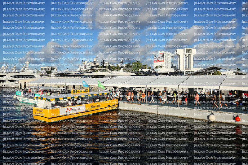 EDITORIAL USE ONLY:  Water Taxi stops to pick up passengers at the Fort Lauderdale International Boat Show Bahia Mar location.
