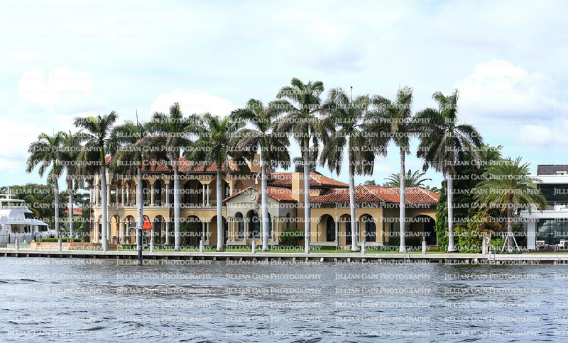 Fort Lauderdale waterfront home surrounded by royal palm trees.