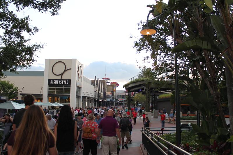 People walk towards the Disneystyle store at Disney Springs