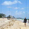 Tourist walking along the surf's edge on Fort Lauderdale Beach