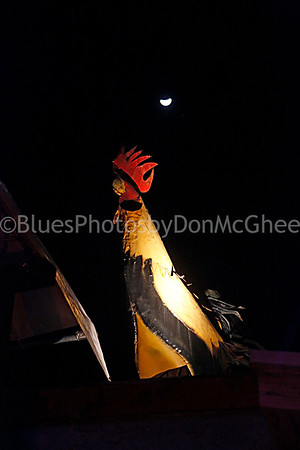 The moon & a rooster on the roof