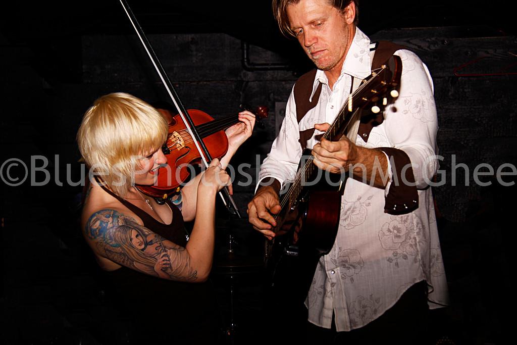 "Rebecca Dawkins, Tim O'Donnell <br>Nouveaux Honkies band <br><a href=""http://tnhband.com/"" target=""_blank"">http://tnhband.com/ </a>"