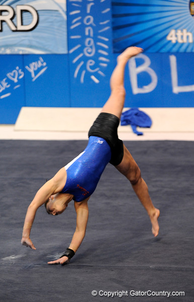 (Casey Brooke Lawson / Gator Country) UF freshman Elizabeth Mahlich showcases floor skills during the University of Florida gymnastics fan day in Gainesville, Fla., on January 4, 2009.