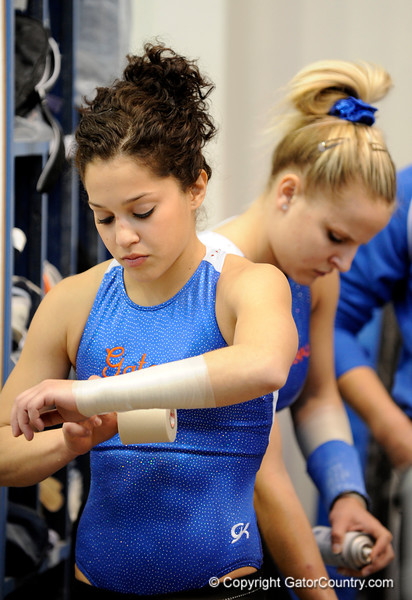 (Casey Brooke Lawson / Gator Country) Amanda Castillo prepares her wrists for the University of Florida gymnastics fan day in Gainesville, Fla., on January 4, 2009.