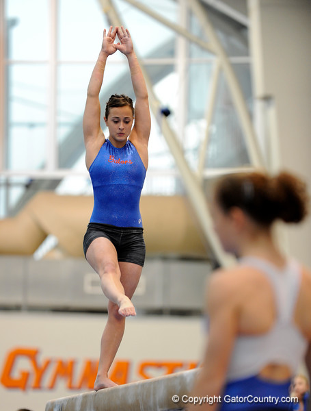 (Casey Brooke Lawson / Gator Country) UF freshman Elizabeth Mahlich showcases a beam demonstration during the University of Florida gymnastics fan day in Gainesville, Fla., on January 4, 2009.