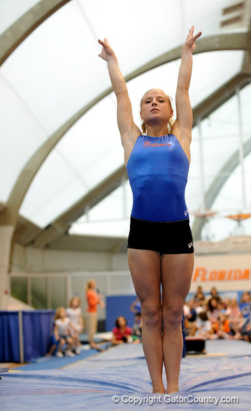 (Casey Brooke Lawson / Gator Country) UF senior Corey Hartung showcases a beam demonstration during the University of Florida gymnastics fan day in Gainesville, Fla., on January 4, 2009.