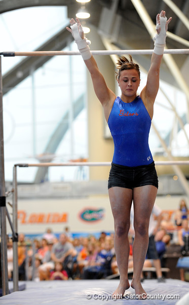 (Casey Brooke Lawson / Gator Country) UF freshman Elizabeth Mahlich showcases a bar demonstration during the University of Florida gymnastics fan day in Gainesville, Fla., on January 4, 2009.