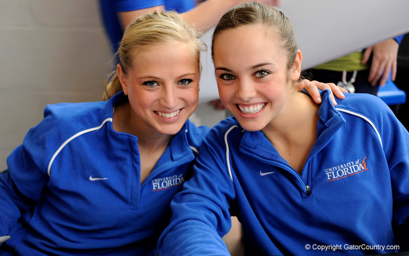 (Casey Brooke Lawson / Gator Country) UF senior Corey Hartung and sophomore Alicia Goodwin pose during an autograph signing during the University of Florida gymnastics fan day in Gainesville, Fla., on January 4, 2009.
