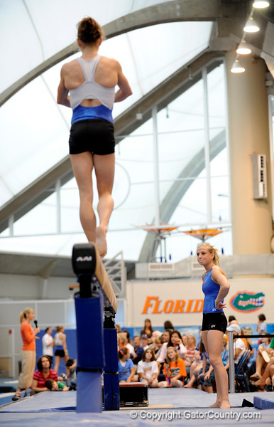 (Casey Brooke Lawson / Gator Country) UF senior Corey Hartung watches as teammate junior Rebekah Zaiser showcases a beam demonstration during the University of Florida gymnastics fan day in Gainesville, Fla., on January 4, 2009.
