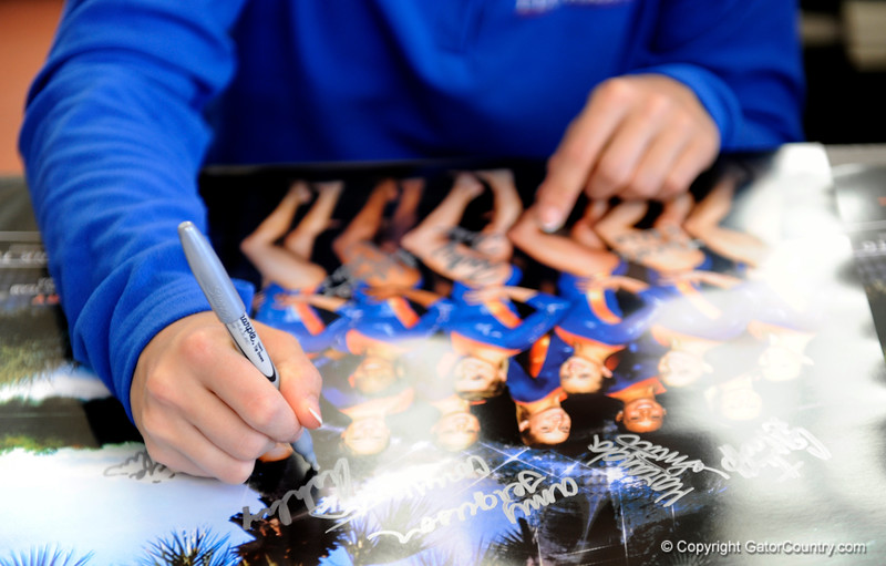 (Casey Brooke Lawson / Gator Country) UF freshman Elizabeth Mahlich signs posters during the University of Florida gymnastics fan day in Gainesville, Fla., on January 4, 2009.