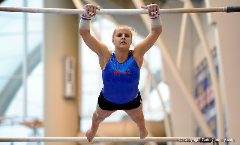 (Casey Brooke Lawson / Gator Country) UF junior Courtney Gladys showcases a bar demonstration during the University of Florida gymnastics fan day in Gainesville, Fla., on January 4, 2009.