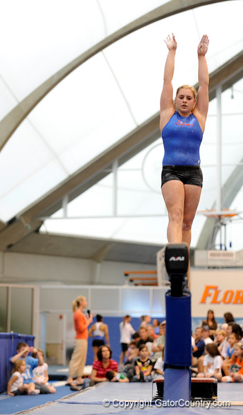 (Casey Brooke Lawson / Gator Country) UF freshman Kailey Tissue showcases a beam demonstration during the University of Florida gymnastics fan day in Gainesville, Fla., on January 4, 2009.