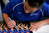 (Casey Brooke Lawson / Gator Country) UF freshman Nicole Ellis signs posters during the University of Florida gymnastics fan day in Gainesville, Fla., on January 4, 2009.