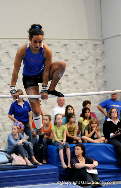 (Casey Brooke Lawson / Gator Country) UF junior Maranda Smith showcases a bar demonstration during the University of Florida gymnastics fan day in Gainesville, Fla., on January 4, 2009.