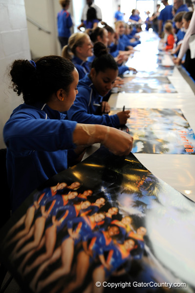 (Casey Brooke Lawson / Gator Country) Junior Maranda Smith signs posters during the University of Florida gymnastics fan day in Gainesville, Fla., on January 4, 2009.