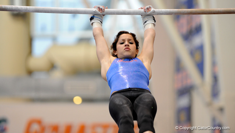 (Casey Brooke Lawson / Gator Country) UF junior Amanda Castillo showcases a bar demonstration during the University of Florida gymnastics fan day in Gainesville, Fla., on January 4, 2009.