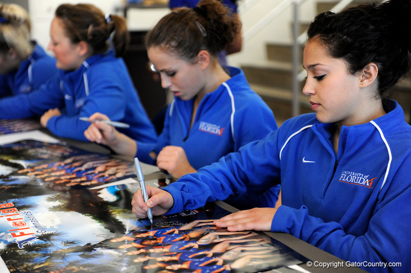 (Casey Brooke Lawson / Gator Country) UF junior Amanda Castillo signs posters during the University of Florida gymnastics fan day in Gainesville, Fla., on January 4, 2009.