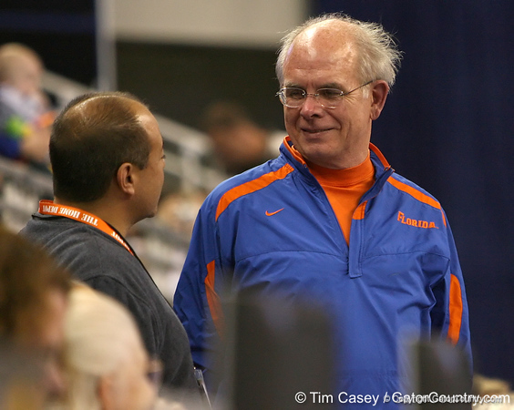 photo by Tim Casey<br /> <br /> University of Florida president Bernie Machen during the Gators' 196.850-196.825 loss to the Georgia Bulldogs on Friday, January 18, 2008 at the Stephen C. O'Connell Center in Gainesville, Fla.