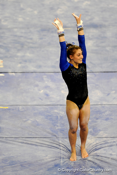 (Casey Brooke Lawson / Gator Country) Freshman Nicole Ellis competes on bars during the Gators victory over the Oklahoma Sooners in Gainesville, Fla., on January 9, 2009.