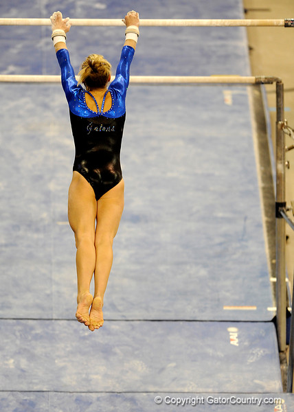 (Casey Brooke Lawson / Gator Country) Senior Corey Hartung competes on bars during the Gators victory over the Oklahoma Sooners in Gainesville, Fla., on January 9, 2009.