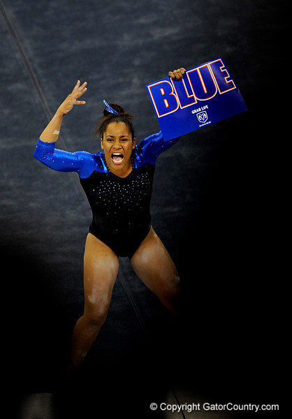 (Casey Brooke Lawson / Gator Country) Junior Melanie Sinclair cheers with the crowd before competing on floor during the Gators victory over the Oklahoma Sooners in Gainesville, Fla., on January 9, 2009.
