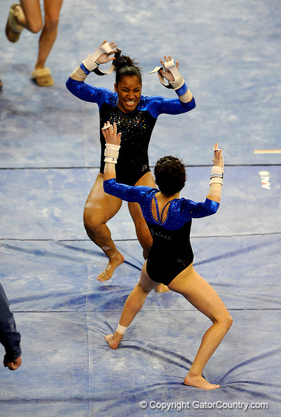 (Casey Brooke Lawson / Gator Country) Junior Amanda Castillo competes on bars during the Gators victory over the Oklahoma Sooners in Gainesville, Fla., on January 9, 2009.